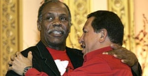 The Venezuelan president, Hugo Chavez (right), and actor Danny Glover embrace
