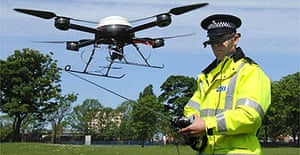 A police officer operates the new CCTV 'spy drone'