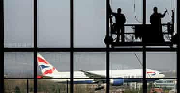 Workers clean Heathrow's Terminal 5 building