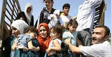 Refugees flee the fighting in Nahr al-Bared