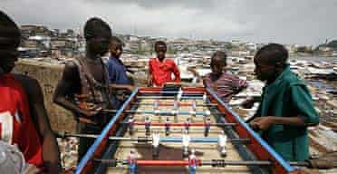 Playing table football in Freetown, Sierra Leone