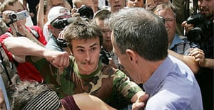 A Russian ultra-nationalist about to punch veteran British gay rights campaigner Peter Tatchell during a denonstration in Moscow