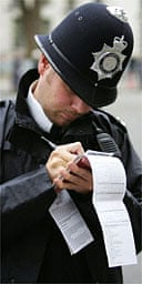 A police officer fills in a stop and search form