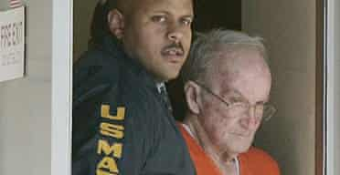 A US marshal escorts James Ford Seale, 71, from the federal courthouse in Jackson, Mississippi.