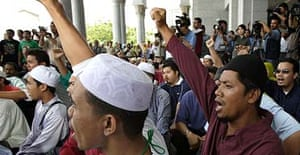 Muslims in Malaysia celebrate the court's decision rejecting Lina Joy's appeal to be recognised as a Christian