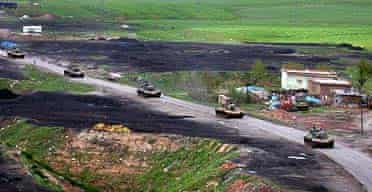 Turkish tanks gathering in the south-eastern town of Cizre, less than 40 miles from Iraq's northern border