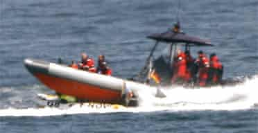 German police run over a Greenpeace boat in the exclusion zone near the G8 summit at Heiligendamm