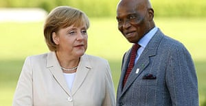 The German chancellor, Angela Merkel, greets the president of Senegal, Abdoulaye Wade, at the G8 summit