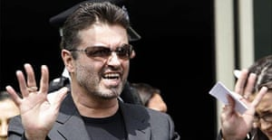 George Michael emerges from Brent Magistrates Court where he was ordered to do 100 hours community service after he admitted being unfit to drive through drugs