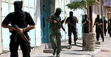 Hamas militants patrol in Gaza City