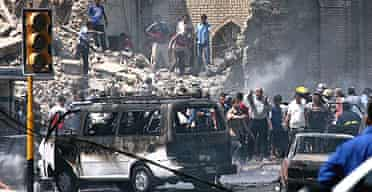 The aftermath of a truck bomb attack on the Shia Khillani mosque in Baghdad, in which at least 75 people were killed