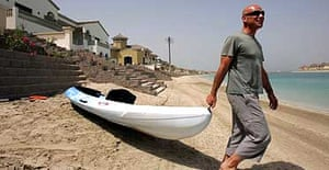 Andrew Dukes beside his home on the Jumeira Palm Island in Dubai.