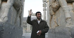 Iran's president, Mahmoud Ahmadinejad, waves to tourists during a visit to the ancient imperial city of Persepolis.
