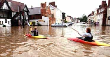 Canoeists take to the floodwaters in Beverley, East Yorkshire.  Photograph: Owen Humphreys/Press Association