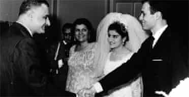 Nineteen-year-old Mona Nasser, centre, smiles up at her father, President Nasser of Egypt, left, as he shakes hands with his son-in-law, chemist Ashraf Marwan, right, during Ashraf's wedding to Nasser's daughter, in a July 7, 1966 file photo. Mrs Nasser is also seen. Photograph: AP