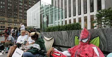People wait in line outside Apple's flagship store on Fifth Avenue, New York, to be among the first to buy the iPhone.