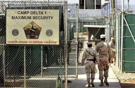 U.S. military guards walk within Camp Delta military-run prison, at the Guantanamo Bay U.S. Naval Base, Cuba