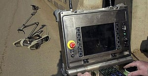 A US army technician uses a current generation PackBot in Baghdad, the new version will have Taser guns attached.