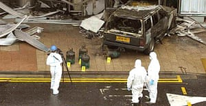 Forensic officers at the scene of Saturday's attack on the terminal building at Glasgow Airport