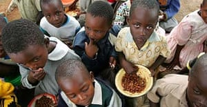 Primary school pupils in Bikita, eastern Zimbabwe, queue for their daily ration of beans and cereal