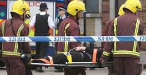 A passenger hurt after a tube train derailed is carried away for treatment