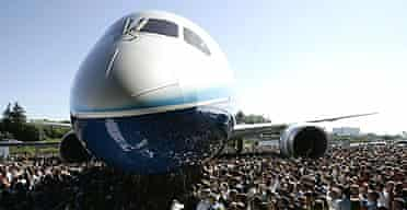 Visitors crowd around the first production model of the new Boeing 787 Dreamliner