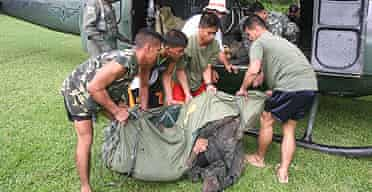 Philippine troops retrieve the bodies of 14 soldiers killed in clashes with MILF rebels