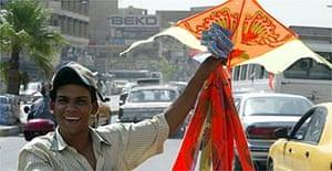 An Iraqi youth sells kites