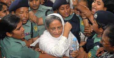 Police escort former Bangladeshi prime minister and Awami League president, Sheikh Hasina, to a court in Dhaka