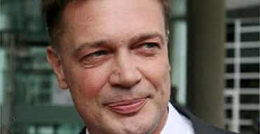 Doctor Andrew Wakefield leaves the General Medical Council Discipliniary Council in London
