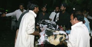 A victim of the suicide blast in Islamabad is carried from the scene