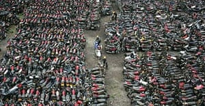 Illegal motorbikes lined up to be destroyed in Guangzhou to curb pollution