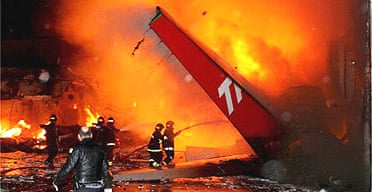 Brazilian firemen try to control the fire that broke out after a TAM airlines plane crashed during landing at the Congonhas Airport in Sao Paulo, Brazil