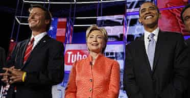Democratic presidential candidates John Edwards, Hillary Clinton and Barack Obama are applauded on stage prior to the start of the CNN/YouTube debate.