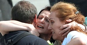 Bulgarian nurse Valentina Siropulo (c) hugs her relatives after arriving at Sofia airport