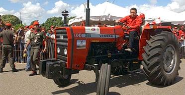 Venezuela's president Hugo Chavez rides a tractor made in Venezuela through a joint venture with Iran in Ciudad Bolivar, Venezuela