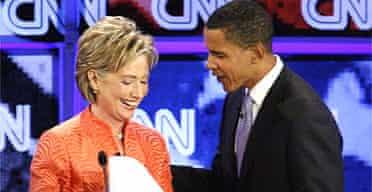 New York Senator Hillary Clinton speaks with Illinois Senator Barack Obama after the CNN/YouTube Democratic presidential candidates debate