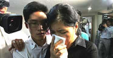 Relatives of the 22 kidnapped South Koreans in Afghanistan react to a television news programme about their loved ones
