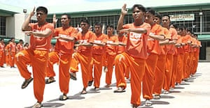 Prisoners at the Cebu detention centre perform a choreographed dance routine as part of their exercise regime