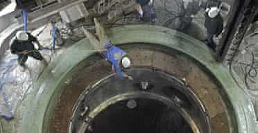 Technicians work at the Bushehr nuclear power plant, 750 miles south of Tehran