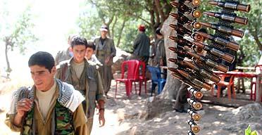 Guerillas of the separatist Kurdistan Workers' party (PKK) near the Turkish border in the remote village of Lewzhe, in northern Iraq.