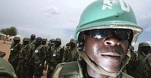 African Union soldiers stand guard at the Kor Abeche mission site, in southern Darfur.