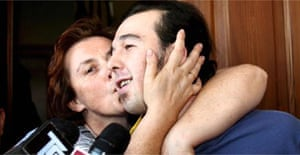 Alberto Zabbialini is kissed by his mother Francesca in Muscoline, Brescia, Italy. Zabbialini, 28, was hiding in the wood close to Savona in Liguria for three months because he thought that he was infected with HIV. Photograph: Filippo Venezia/EPA
