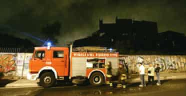 Italian firefighters work outside Rome's famed Cinecitta film studios where a large fire broke out overnight.
