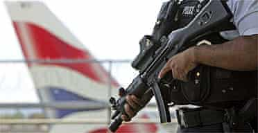 An armed British police officer on patrol outside Heathrow airport