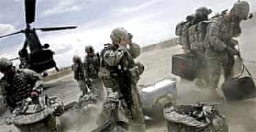 US soldiers disembark from a Chinook helicopter in the Ghazni province of Afghanistan