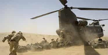 British soldiers loading supplies into a Chinook helicopter in southern Helmand province, Afghanistan