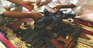 Weapons change hands for cash in a Baghdad home
