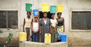 This mother and her four daughters must fetch 20 buckets of water a day for their household in Dar es Salaam