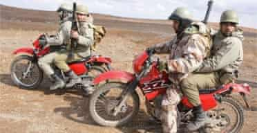 Iranian Revolutionary Guards riding red Honda motorcycles. Photograph: AFP/Getty